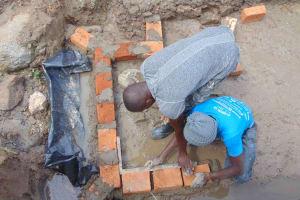 The Water Project: Shamoni Community, Shiundu Spring -  Brickwork