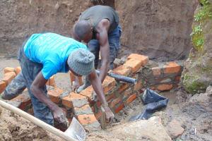 The Water Project: Shamoni Community, Shiundu Spring -  Pipe Install
