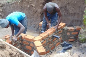The Water Project: Shamoni Community, Shiundu Spring -  Pipe Installed