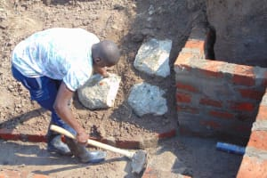 The Water Project: Shamoni Community, Shiundu Spring -  Pitching Stone