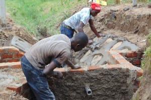 The Water Project: Shamoni Community, Shiundu Spring -  Plastering