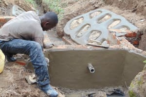 The Water Project: Shamoni Community, Shiundu Spring -  Plastering Outside