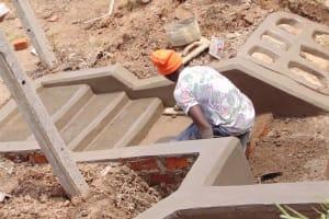 The Water Project: Shamoni Community, Shiundu Spring -  Plastering Stairs