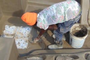 The Water Project: Shamoni Community, Shiundu Spring -  Plastering Floor