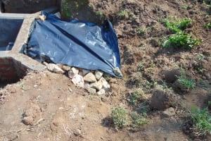 The Water Project: Shamoni Community, Shiundu Spring -  Backfilling
