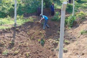 The Water Project: Shamoni Community, Shiundu Spring -  Soil Cover