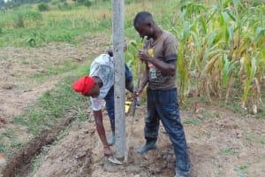 The Water Project: Shamoni Community, Shiundu Spring -  Installing Fencing