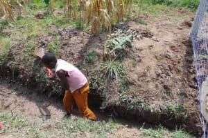 The Water Project: Shamoni Community, Shiundu Spring -  Opening Drainage