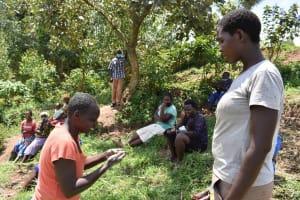 The Water Project: Shamoni Community, Shiundu Spring -  Participant Washing Hands