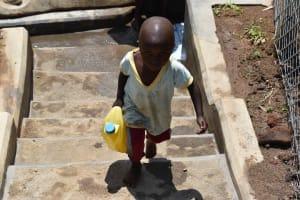 The Water Project: Shamoni Community, Shiundu Spring -  Child Fetching Water