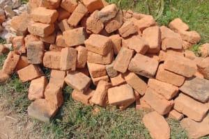 The Water Project: Shamoni Community, Laban Ang'ata Spring -  Bricks