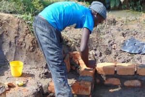The Water Project: Shamoni Community, Laban Ang'ata Spring -  Raising The Wall