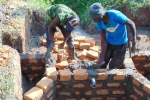 The Water Project: Shamoni Community, Laban Ang'ata Spring -  Pipe Set