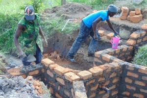 The Water Project: Shamoni Community, Laban Ang'ata Spring -  Walls Getting Taller