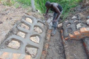 The Water Project: Shamoni Community, Laban Ang'ata Spring -  Pitching Rocks