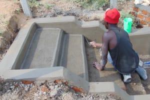 The Water Project: Shamoni Community, Laban Ang'ata Spring -  Plastering Stairs