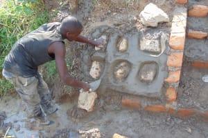 The Water Project: Shamoni Community, Laban Ang'ata Spring -  Stone Pitching