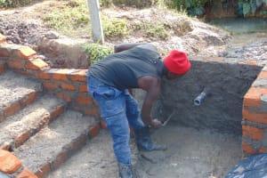 The Water Project: Shamoni Community, Laban Ang'ata Spring -  Plastering