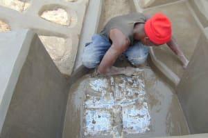 The Water Project: Shamoni Community, Laban Ang'ata Spring -  Plastering Floor