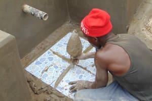 The Water Project: Shamoni Community, Laban Ang'ata Spring -  Setting Tile