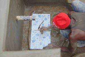 The Water Project: Shamoni Community, Laban Ang'ata Spring -  Tile Setting