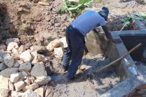 The Water Project: Shamoni Community, Laban Ang'ata Spring -  Backfilling Clay