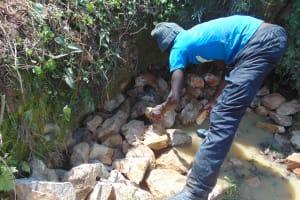 The Water Project: Shamoni Community, Laban Ang'ata Spring -  Backfilling Stone