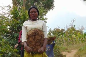 The Water Project: Shamoni Community, Laban Ang'ata Spring -  Bringing Sod