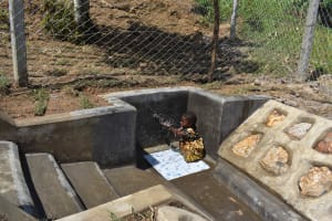 The Water Project: Shamoni Community, Laban Ang'ata Spring -  Girl Playing