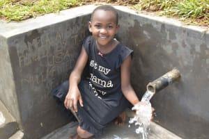 The Water Project: Mundoli Community, Pamela Atieno Spring -  Enjoying Water