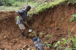 The Water Project: Mundoli Community, Pamela Atieno Spring -  Backfilling With Soil