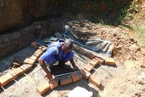 The Water Project: Mundoli Community, Pamela Atieno Spring -  Brick Setting