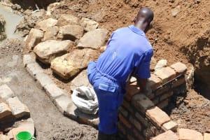 The Water Project: Mundoli Community, Pamela Atieno Spring -  Wall Construction