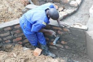 The Water Project: Mundoli Community, Pamela Atieno Spring -  Plastering
