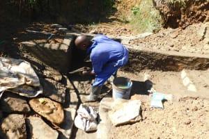 The Water Project: Mundoli Community, Pamela Atieno Spring -  Stone Pitching