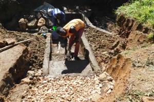 The Water Project: Mundoli Community, Pamela Atieno Spring -  Staircase Construction