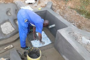 The Water Project: Mundoli Community, Pamela Atieno Spring -  Tiles Fitting