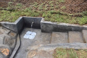 The Water Project: Mundoli Community, Pamela Atieno Spring -  Flowing Water