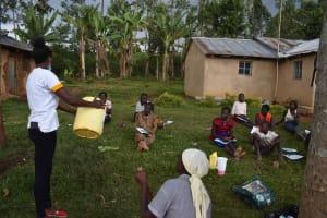 The Water Project: Mundoli Community, Pamela Atieno Spring -  Water Handling Topic