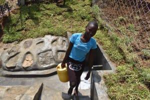 The Water Project: Mundoli Community, Pamela Atieno Spring -  Fetching Water
