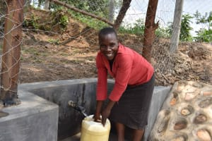The Water Project: Lunyinya Community, Makunga Spring -  Community Members Fetching Water
