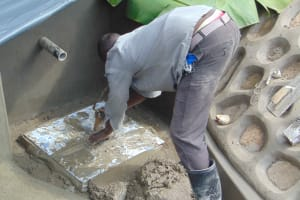 The Water Project: Lunyinya Community, Makunga Spring -  Tile Setting