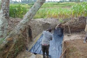 The Water Project: Lunyinya Community, Makunga Spring -  Slab Setting