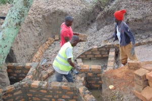 The Water Project: Lunyinya Community, Makunga Spring -  Wall Construction