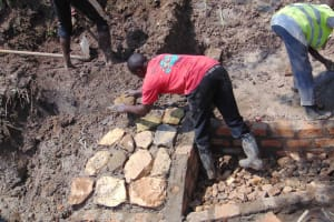 The Water Project: Lunyinya Community, Makunga Spring -  Stone Pitching