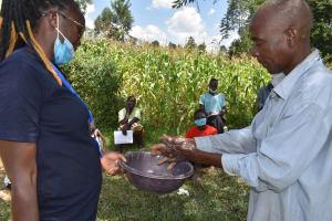 The Water Project: Lunyinya Community, Makunga Spring -  Handwashing Demonstration