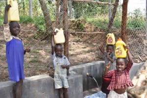 The Water Project: Lunyinya Community, Makunga Spring -  Children Carrying Water