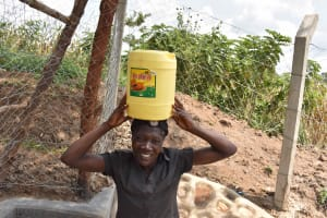 The Water Project: Lunyinya Community, Makunga Spring -  Community Members Carrying Water