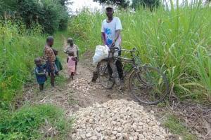 The Water Project: Makunga Community, Tabarachi Spring -  Bringing Gravel