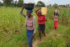 The Water Project: Makunga Community, Tabarachi Spring -  Carrying Materials
